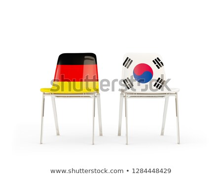 Two chairs with flags of germany and south korea isolated on whi Stock photo © MikhailMishchenko