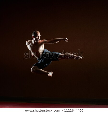 A kick to the side of an athlete beats in a high jump Stock photo © Andreyfire