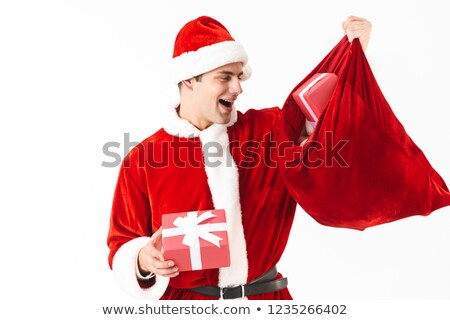 Portrait of generous man 30s in santa claus costume and red hat  Stock photo © deandrobot