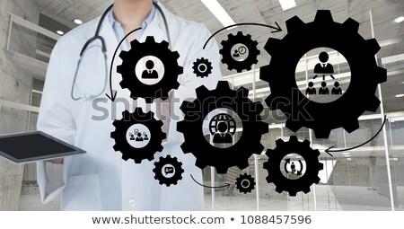 Médico mulher pessoas engrenagens gráficos escritório Foto stock © wavebreak_media
