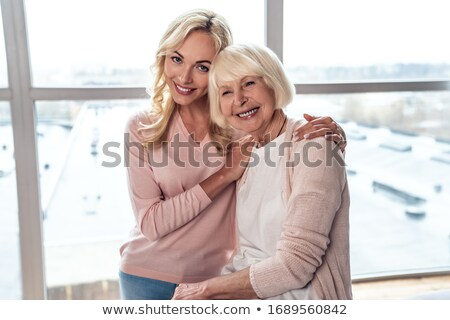 mother smiling with her daughter stock photo © lopolo