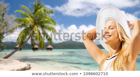 happy woman over tropical beach and bungalow stock photo © dolgachov