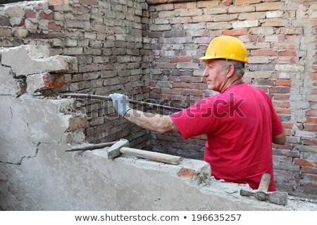 Worker demolish brick wall Stock photo © simazoran