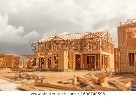 Wood Home Framing Abstract At Construction Site with Stormy Clou Stock photo © feverpitch