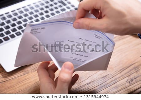 Person Removing Paper From Envelope Stock photo © AndreyPopov