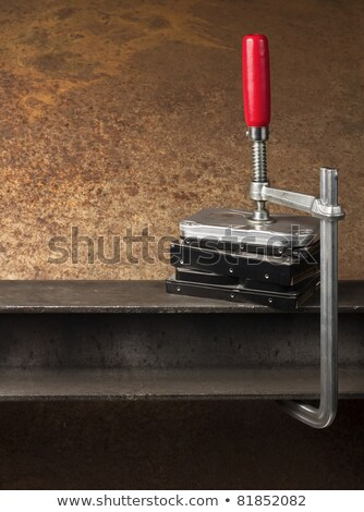 Stock photo: three hard drives pressed together with a clamp
