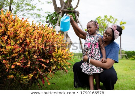 Couple in front of green plants Stock photo © photography33