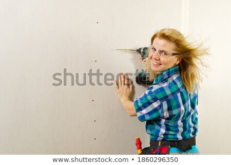 Blond woman holding cordless drill Stock photo © photography33