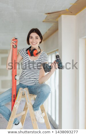 Young woman with a power drill Stock photo © photography33