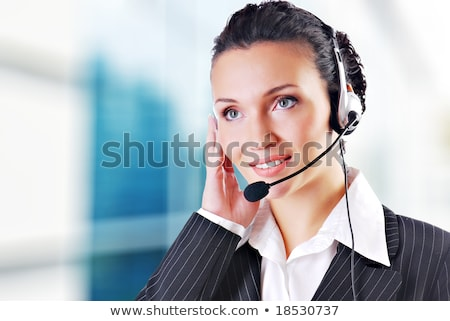 woman wearing headsets could be receptionist stock photo © stockyimages