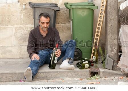 Bêbado homem calçada em pé fumador cigarro Foto stock © smithore