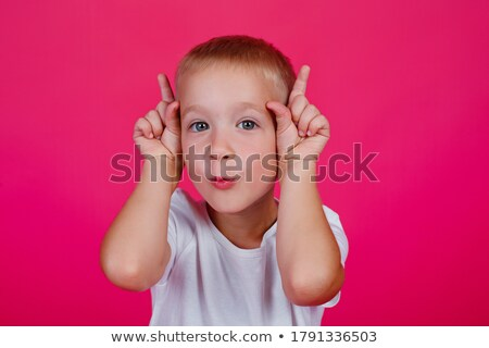 Cheerful kid dressed in casuals Stock photo © stockyimages