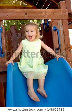 TwoYears Old Girl Fulfilled on the Slide Stock photo © ozgur