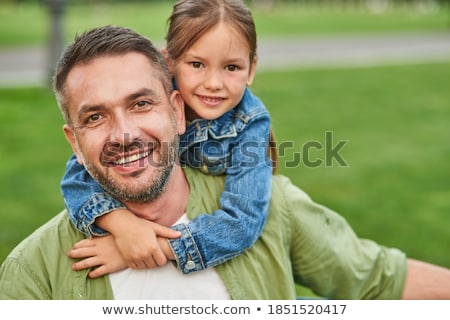 casual man in the grass looks at camera  Stock photo © feedough