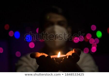 ストックフォト: 肖像 · 若い男 · 石油ランプ · 手 · 火災 · 光