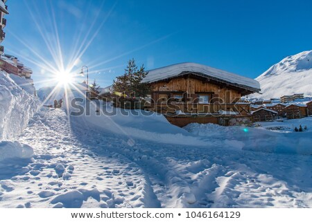 Tignes village with sun and creek Stock photo © vwalakte