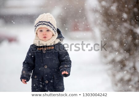 Little boy playing outdoors with snow Stock photo © Bratovanov