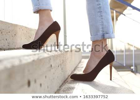 Walking up stairs in stiletto shoes Stock photo © roboriginal