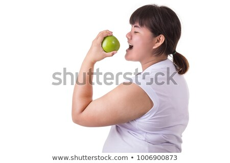 Big green apple in woman hand isolated on white Stock photo © tetkoren