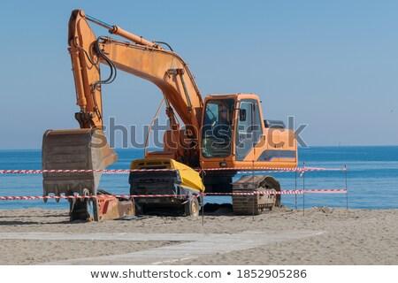 Gépi kotrógép tengerpart dolgozik tengerparti védelem Stock fotó © morrbyte