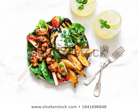 Chicken kebab and roasted potatoes Stock photo © Digifoodstock
