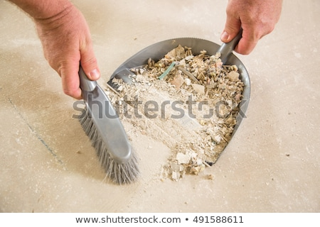 Worker Picking Up Pile of Debris on Cement Stock photo © feverpitch