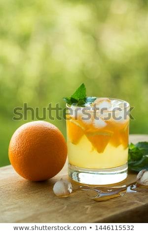 Fresh lemons on the table in the open air. Selective focus. Stock photo © Yatsenko