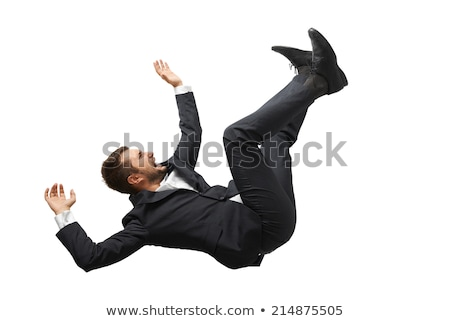 Falling businessman isolated on the white background Stock photo © Elnur