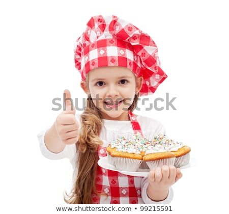 Caucasian child in chef hat holding a cake. Stock photo © RAStudio