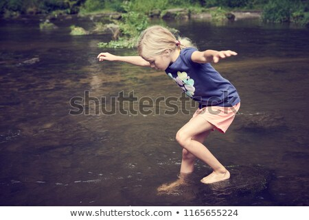 Young girl playing in creek Stock photo © IS2