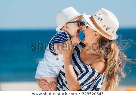 mulher · bebê · praia · família · feliz · mar - foto stock © armstark