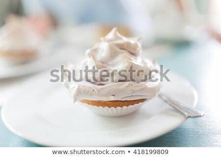 beautiful chocolate cupecake with meringue stock photo © melnyk