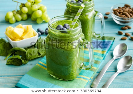 healthy green smoothie with spinach in glass jar stock photo © melnyk
