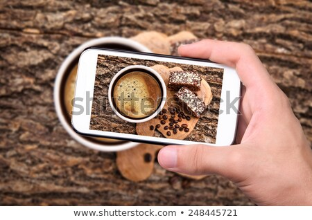 Crop hand taking photo of fresh desserts Stock photo © dash