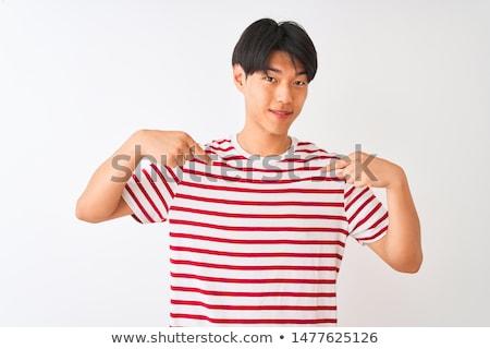 Alegre hombre a rayas camiseta sonriendo senalando Foto stock © deandrobot