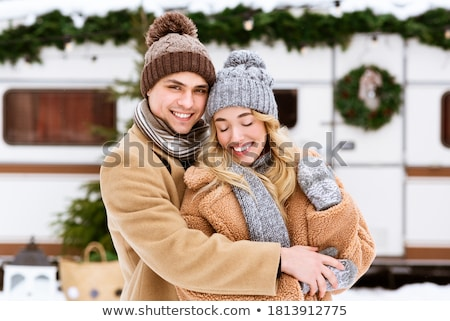 Image of two lovely women wearing hats and scarfs smiling at cam Stock photo © deandrobot