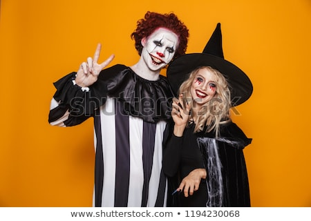 Scary wizard and clown looking and smiling to camera Stock photo © deandrobot