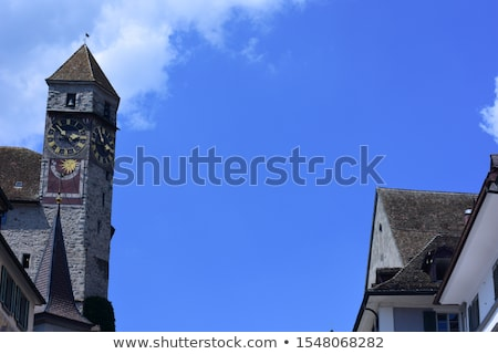 old clocktower on rapperswil castle in switzerland stock photo © boggy