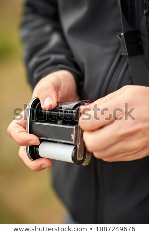 man with a filmstrip in his hand Stock photo © nito