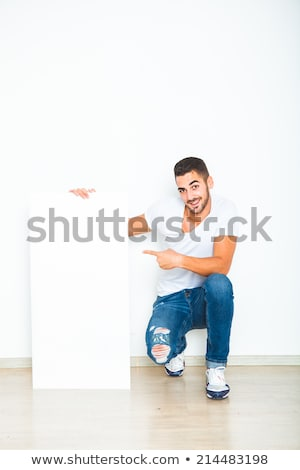 Casually-dressed man smiling showing a thumbs up sign Stock photo © feedough