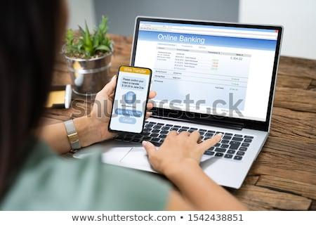 Kadın banka transfer tablet iş Stok fotoğraf © AndreyPopov