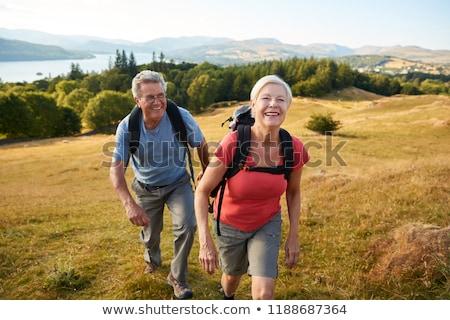 Senior man genieten wandelen platteland mannen Stockfoto © HighwayStarz