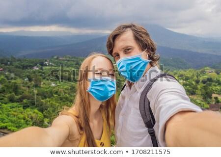 Hombre mujer volcán montana vista Foto stock © galitskaya