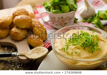 Delicious cheese dip with bread rolls Stock photo © BarbaraNeveu