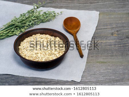 Avena cerámica bolos cuchara de madera Foto stock © marylooo