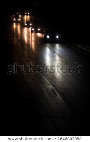 Busy highway at night with cars of commuters going home from work Stock photo © lightpoet