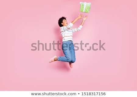 Photo of pretty excited woman expressing surprise and smiling Stock photo © deandrobot