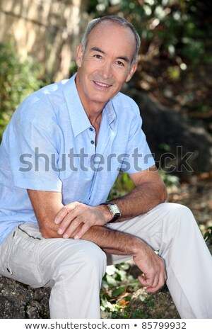 portrait of senior citizen enjoying ramble through nature Stock photo © photography33