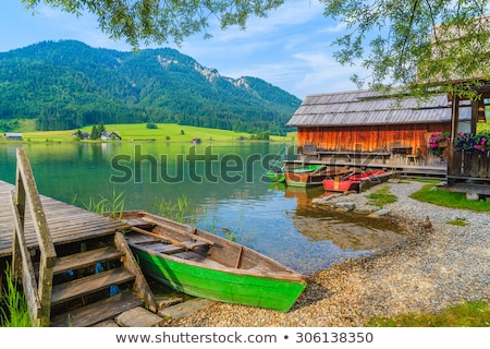 Boat, village and lake Stock photo © raywoo