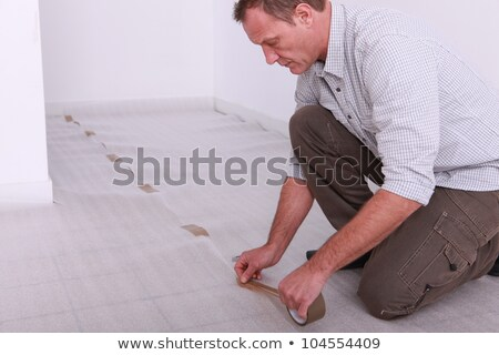 Man taping down underlay Stock photo © photography33
